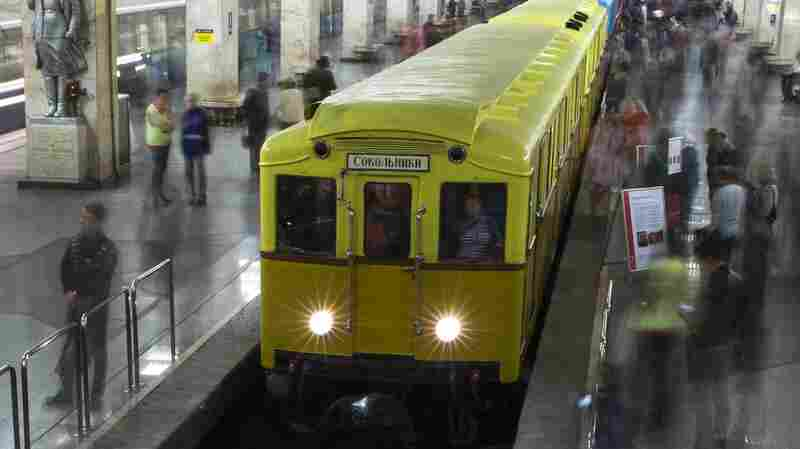 Visitors check out the Soviet-era metro cars exhibited at the Partizanskaya subway station in Moscow, as part of festivities marking the subway system's 80th anniversary.