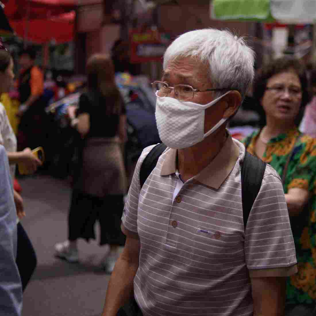 South Koreans Mask Up In The Face Of MERS Scare