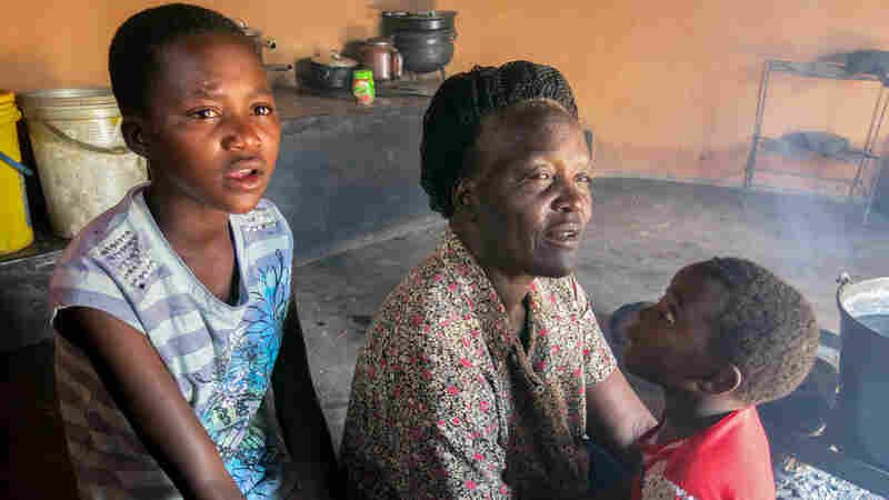 Fadzai Kundishora (left) can no longer go to school because her family can't afford the fees. She spends days at home with her grandmother Miriam Kundishora, doing chores.