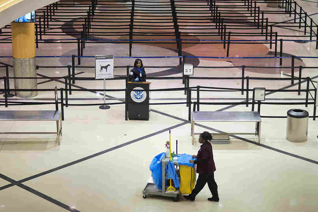 A TSA agent waits for travelers at Hartsfield-Jackson Atlanta International Airport.