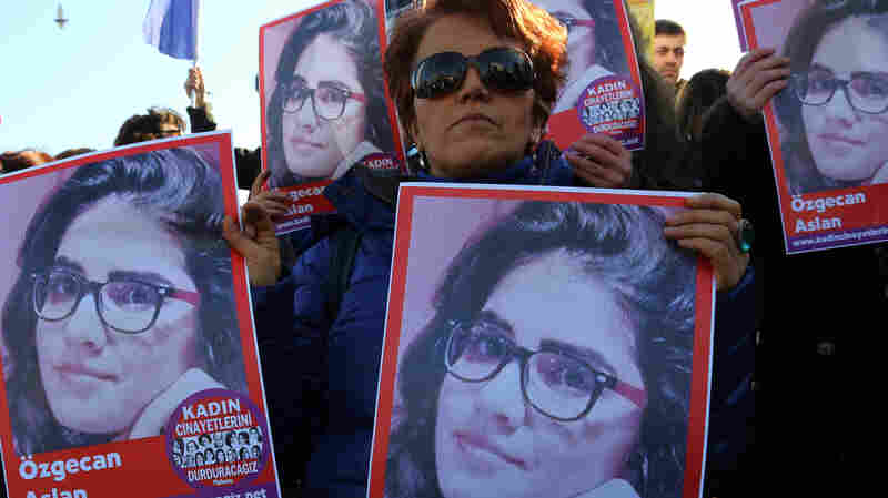 """Demonstrators in the Turkish capital of Ankara hold posters of Ozgecan Aslan, a 20-year-old student who was allegedly killed by a bus driver after fighting off a sexual assault. The posters read: """"End killings of women."""""""