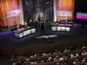 Intelligence Squared U.S. debate stage.