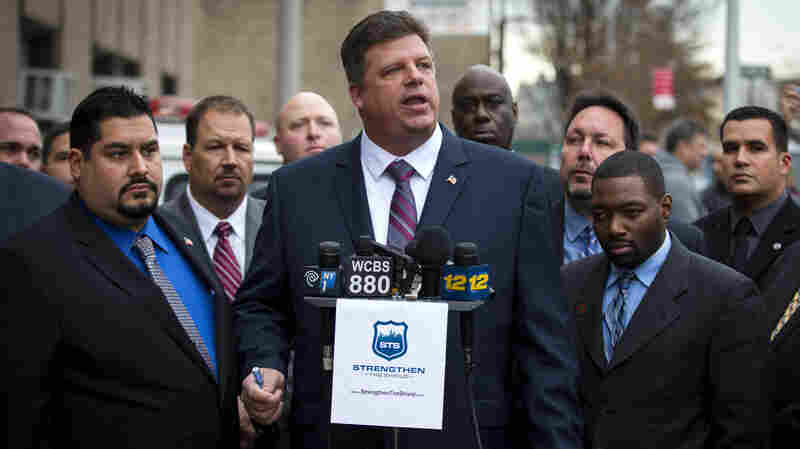 NYPD veteran Brian Fusco speaks to press outside the 72nd Precinct in the Brooklyn borough on Jan. 20. Fusco is running for president of the state's Patrolman's Benevolent Association in the upcoming election, against incumbent Patrick Lynch, who has been an outspoken critic of New York City Mayor Bill de Blasio.