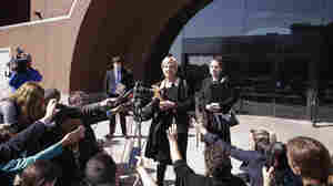 Attorney Jessica Hedges (center) talks to members of the media outside the federal courthouse in Boston after the arraignment of her client David Wright on Wednesday.