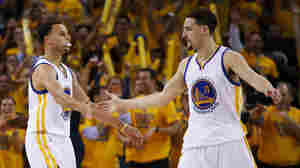 Stephen Curry, left, and Klay Thompson of the Golden State Warriors celebrate in the second quarter Thursday night against the Cleveland Cavaliers during Game One of the 2015 NBA Finals in Oakland, California.