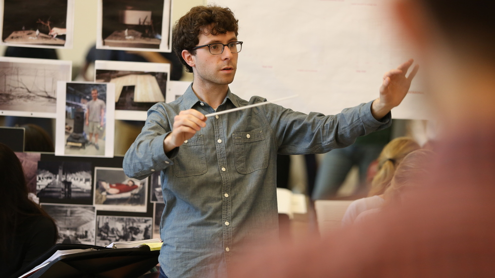 Composer, librettist and conductor Matthew Aucoin in rehearsal.
