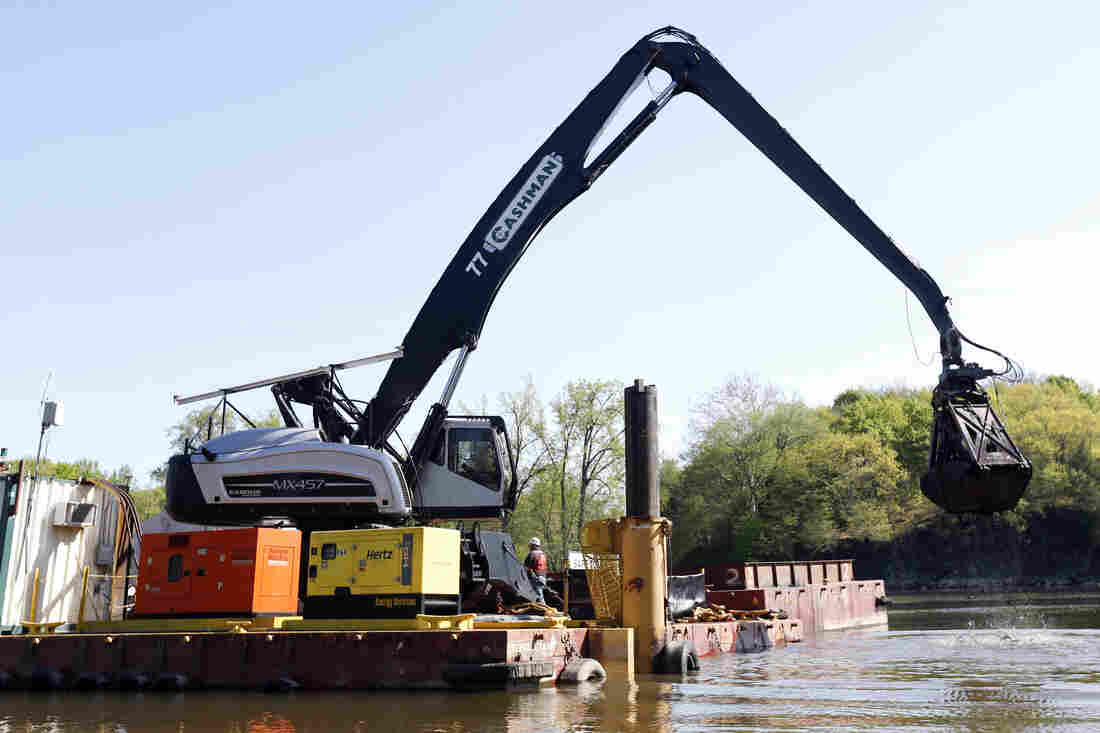 Crews perform dredging work along the upper Hudson River in Waterford, N.Y. General Electric's cleanup of PCBs discharged into the river decades ago will end this year.