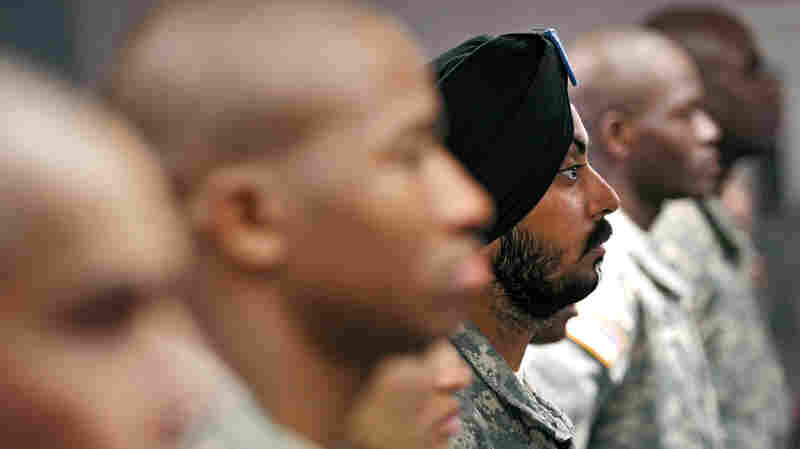 Army Cpl. Simranpreet Lamba (center) stands in formation with fellow soldiers before taking the oath of citizenship, prior to his graduation from basic training at Fort Jackson, S.C., in 2010. He was the first enlisted soldier to be granted a religious accommodation as a Sikh since 1984.