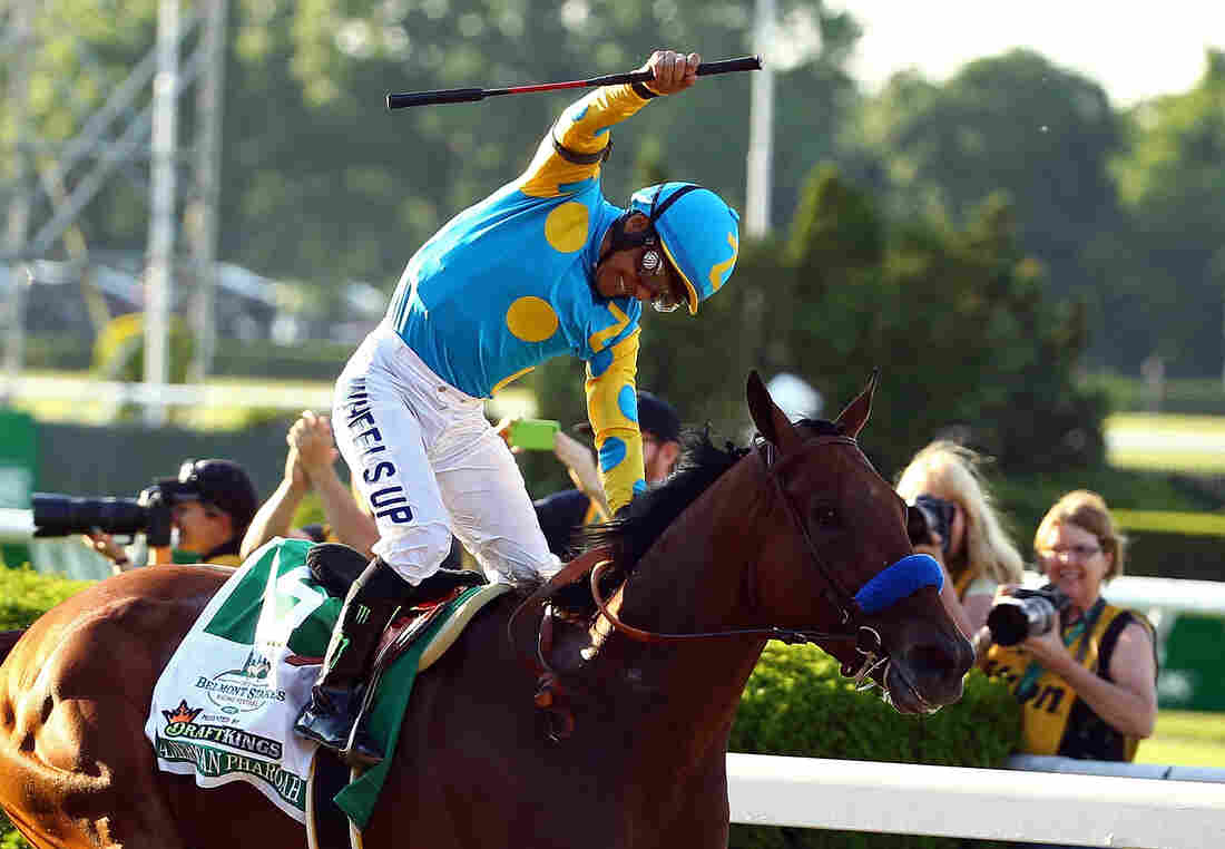Victor Espinoza celebrates atop American Pharoah after winning the 147th running of the Belmont Stakes at Belmont Park on June 6 — the first Triple Crown win since 1978.