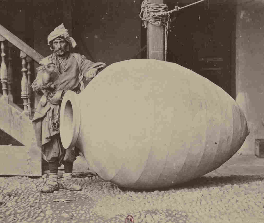 A man stands next to a giant qvevri pot in Kakheti, Georgia, in this photo from the late 1800s. The beeswax-lined vessels have been used to make wine for thousands of years.