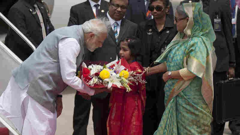 Bangladesh's Prime Minister Sheikh Hasina greets Indian Prime Minister Narendra Modi on Saturday.