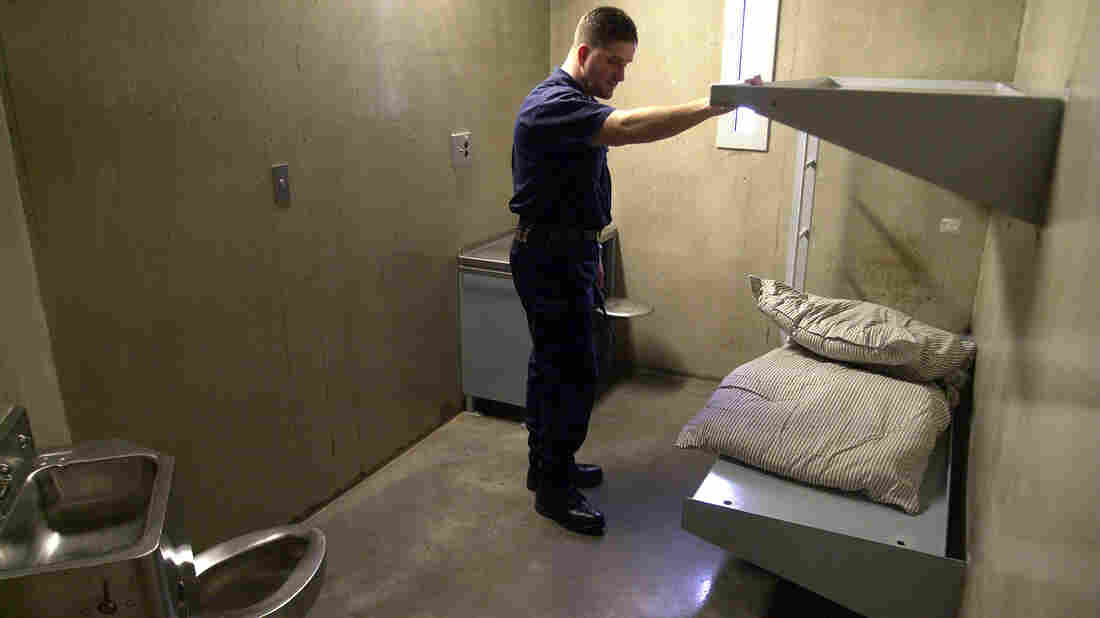 A guard looks over an empty inmate cell at the Northern Correctional Institution in Somers, Conn., in 2001.