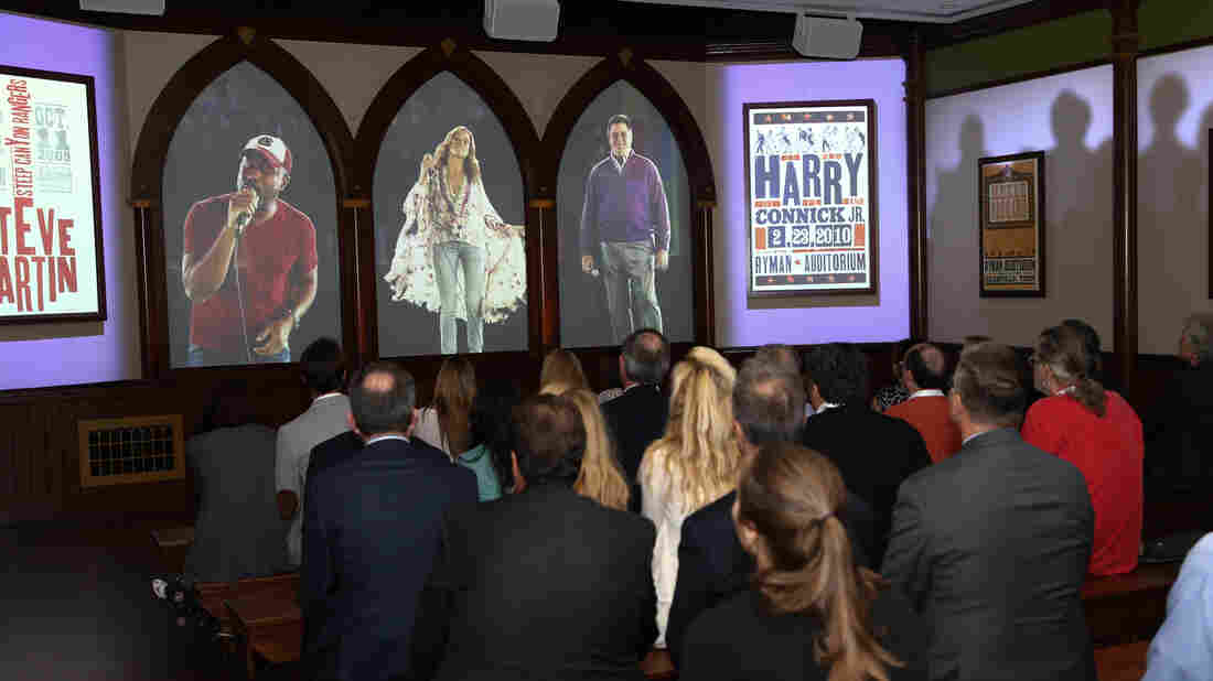 The Soul Of Nashville is projected onto three screens that mimic the Gothic windows of the original Ryman Auditorium structure.