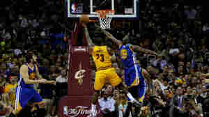 LeBron James of the Cleveland Cavaliers shoots Tuesday against Draymond Green of the Golden State Warriors in the second quarter during Game Three of the NBA Finals in Cleveland.