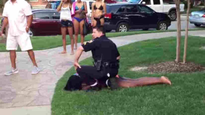 A still from a video showing Cpl. Eric Casebolt forcing a teenager to the ground in McKinney, Texas. Casebolt has resigned as an investigation continues.
