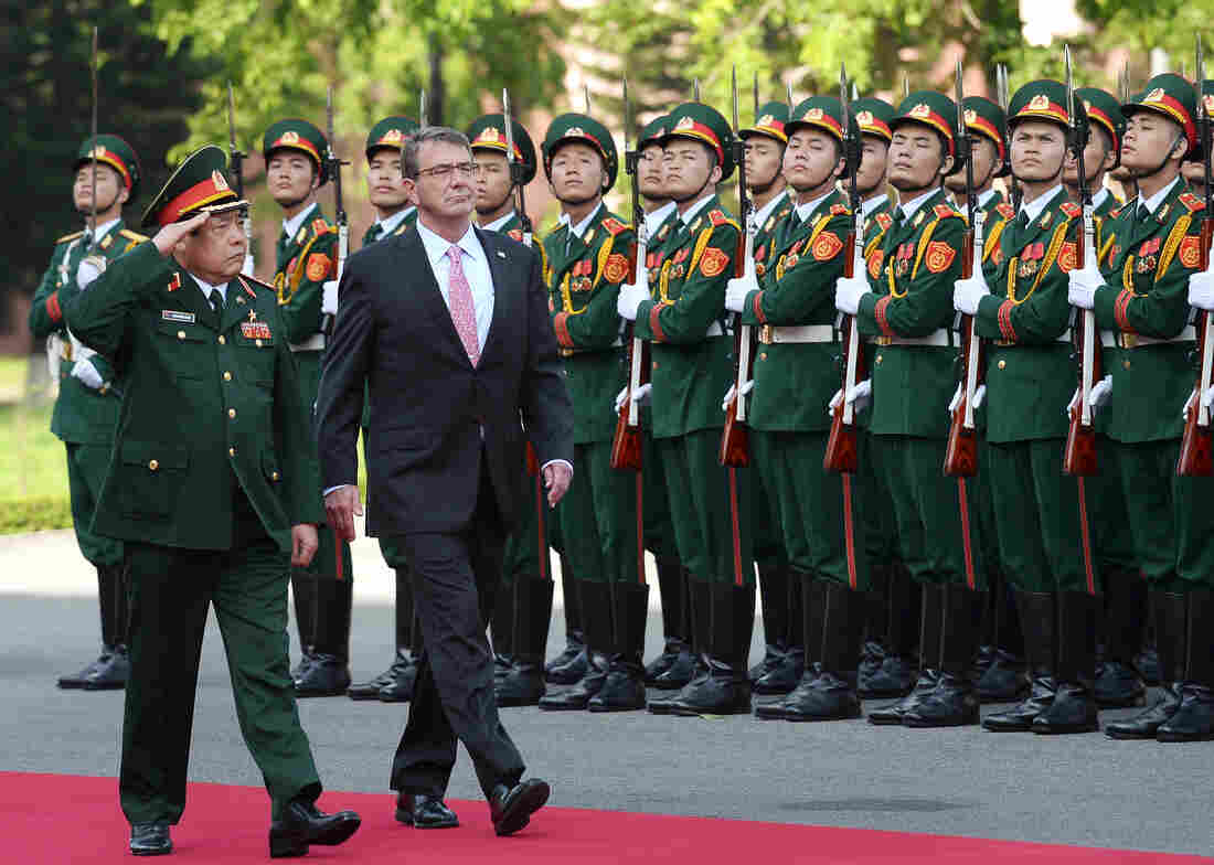 U.S. Defense Secretary Ash Carter, right, and Vietnam's Defense Minister Phung Quang Thanh review the guard of honour during a welcoming ceremony at the Defense Ministry in Hanoi, Vietnam, on June 1. The U.S., Russia, France, the U.K. and other countries are all jockeying to sell military equipment to Southeast Asian countries.