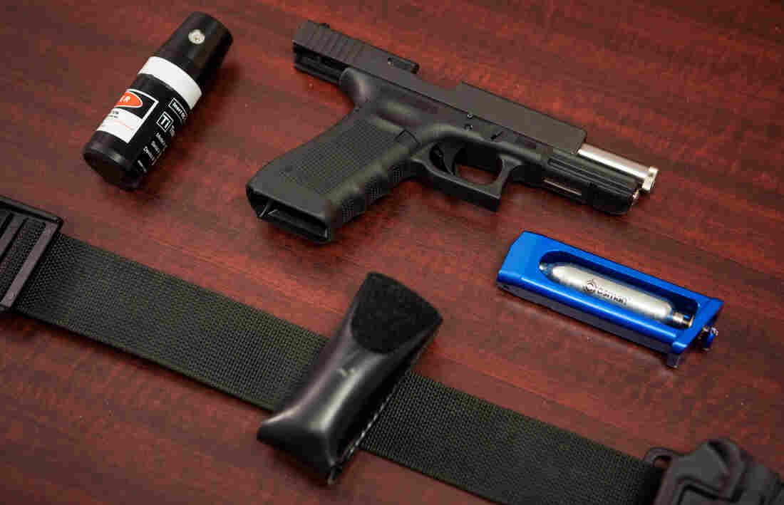 People who run through the Use of Force simulation at the Law Enforcement Legal Defense Fund in Virginia are equipped with a Glock 22 that's been modified to house a laser, with a CO2 cartridge in the magazine, as well as an inert chemical agent that's also been modified to house a laser. Both training weapons are attached to a holster.