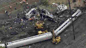 Emergency personnel work at the scene the day after a deadly train derailment on May 12 in Philadelphia.