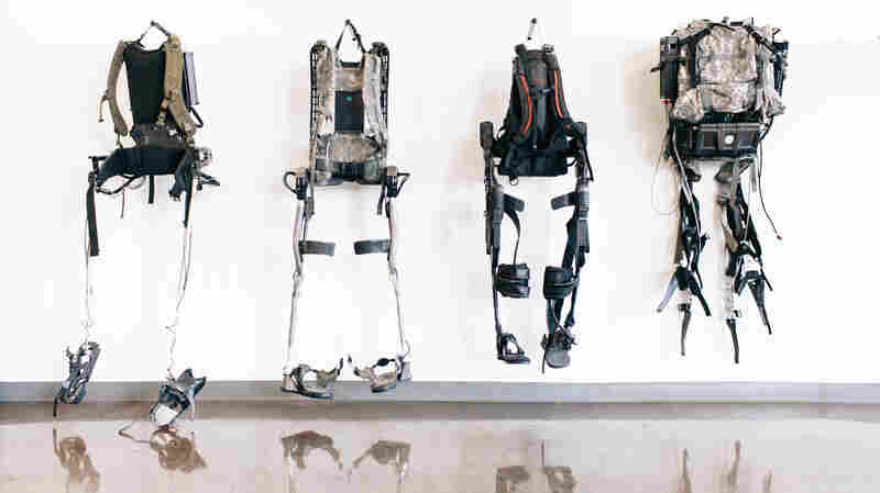 The evolution of exoskeletons, hanging on the wall at Ekso Bionics in Richmond, Calif.