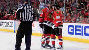 Chicago Blackhawks Jonathan Toews (19) and Patrick Kane (88) confer during Monday's Stanley Cup Final game against the Tampa Bay Lightning.