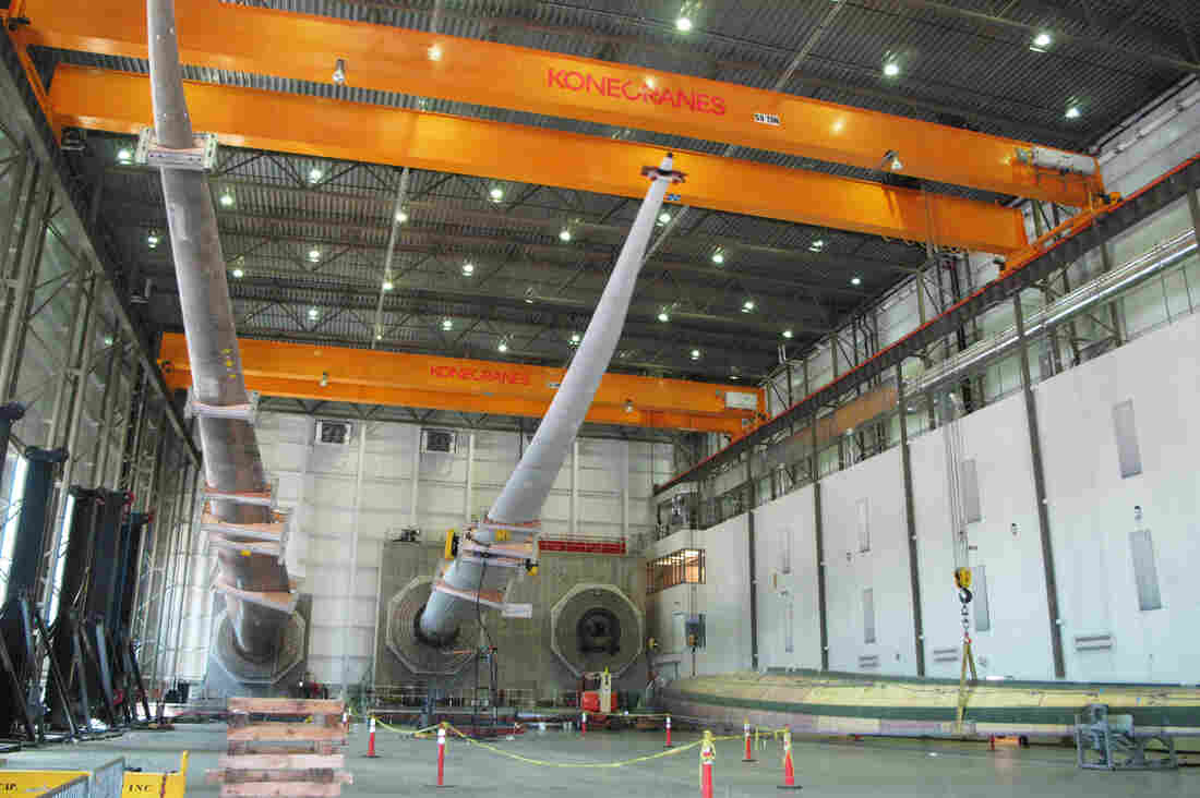 At a wind turbine blade testing facility on Boston Harbor, blades are being flexed to see how they respond to normal wear and tear. The facility can simulate 20 years of wear and tear in a matter of weeks by vigorously flexing the blades.