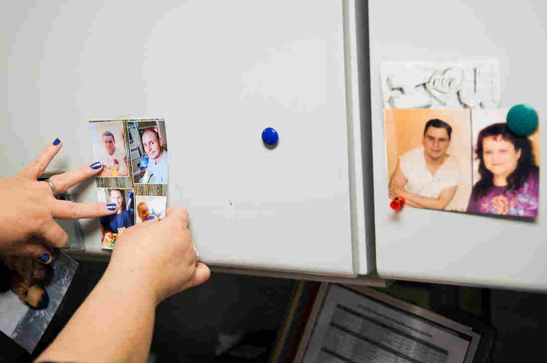 Garcia moves around photos of Mark that hang on her office cabinets at the Austin Independent School District, where she works as a data manager.
