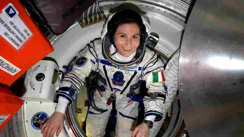 European Space Agency astronaut Samantha Cristoforetti of Italy checks her Sokol pressure suit aboard the International Space Station. Cristoforetti, who set an endurance record, is among three astronauts who returned on Thursday.