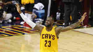 Cavaliers forward LeBron James urges on the crowd during the second half of Game 3 of the NBA Finals against the Golden State Warriors in Cleveland. The Cavs lead the series 2-1 and host Game 4 Thursday night.