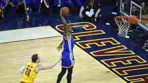 Golden State Warriors guard Andre Iguodala outruns center Cleveland Cavaliers Timofey Mozgov to the hoop Thursday during Game 4 of the NBA Finals in Cleveland.
