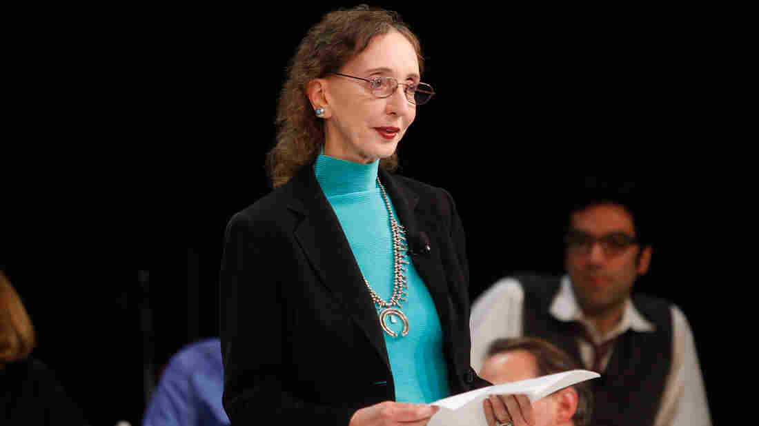 """Author Joyce Carol Oates, seen here at a a panel discussion last October, sparked jokes, and then a debate, by tweeting about the """"barbaric"""" killing of a triceratops."""