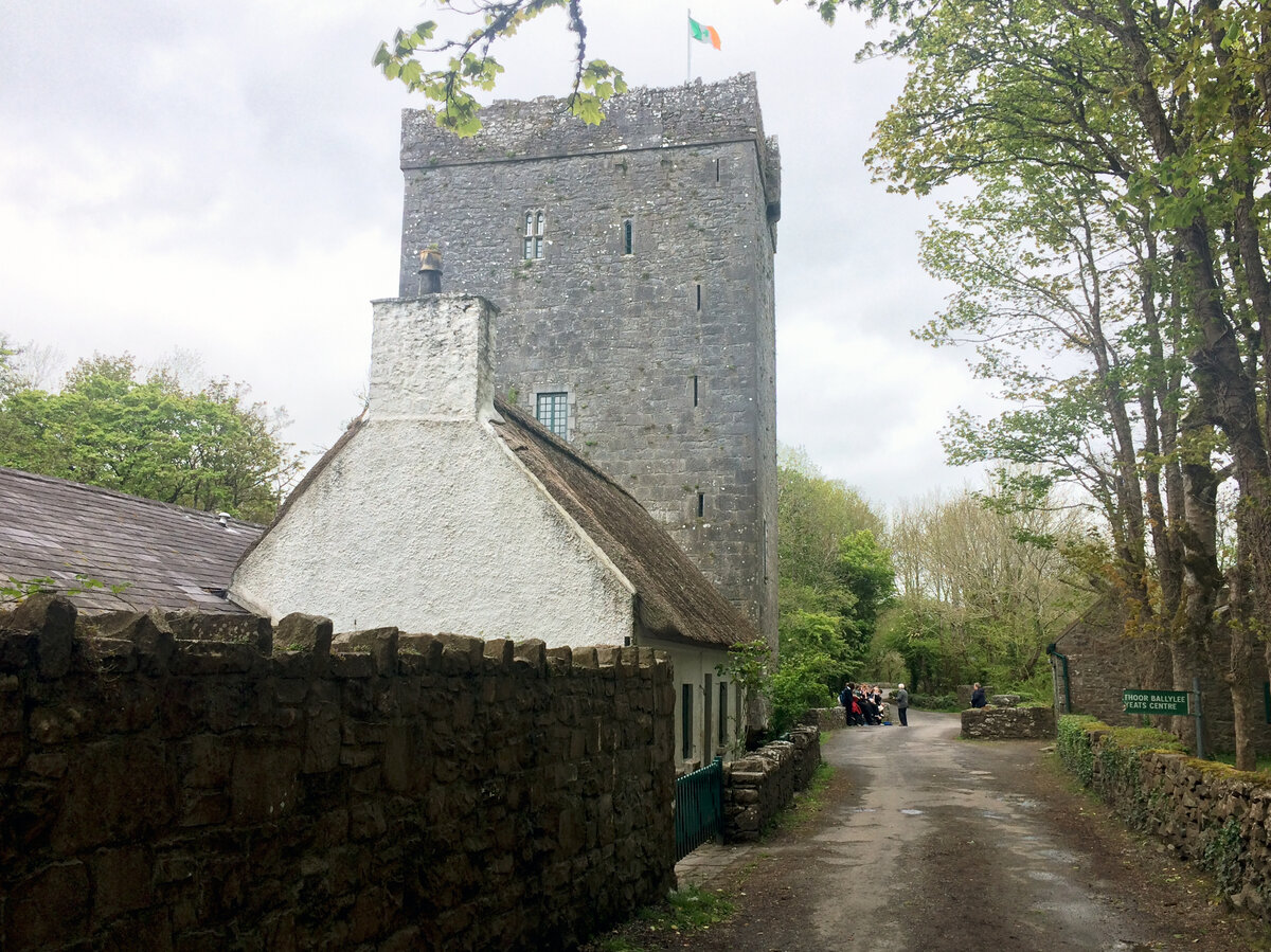 A school group gathers outside Thoor Ballylee, a 15th-century stone tower where Yeats lived for many years.
