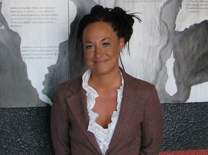 Rachel Dolezal stands in front of a mural she painted, in July 2009.