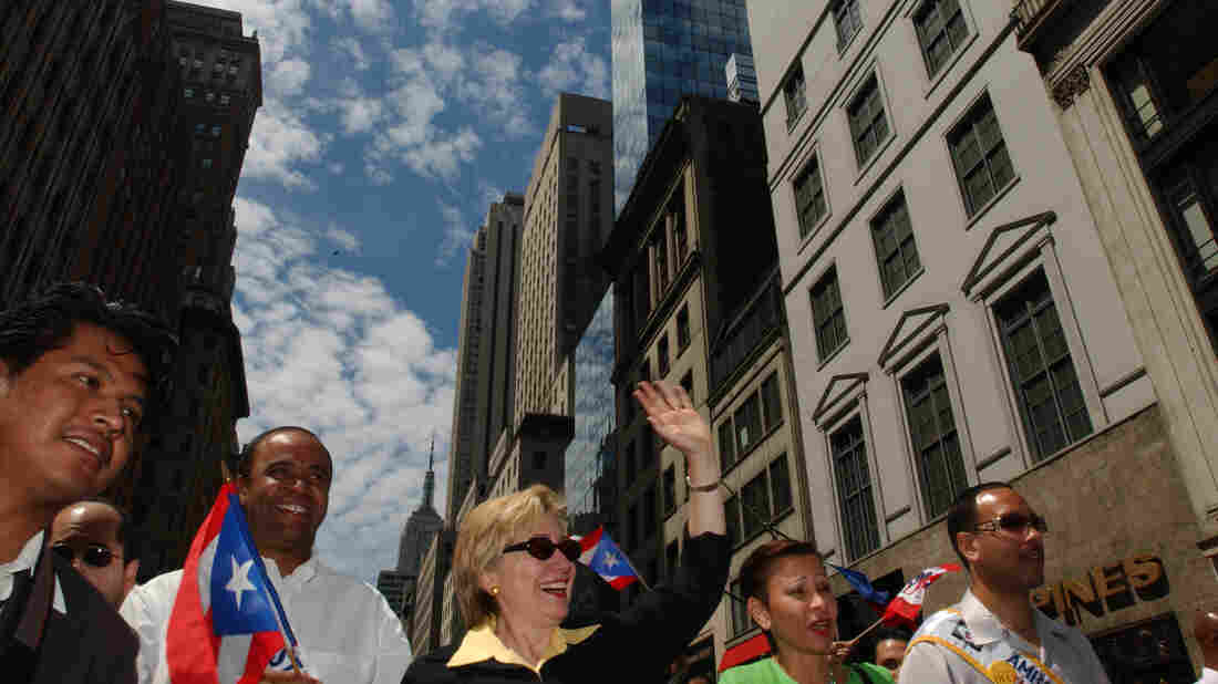 Hillary Clinton, then senator, waves to the crowd during the Puerto Rican Day Parade in New York City in 2004.