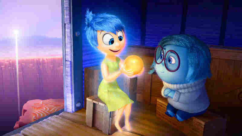 Joy (left, voiced by Amy Poehler) and Sadness (voiced by Phyllis Smith) catch a ride on the Train of Thought in Pixar's Inside Out. The movie opens in theaters nationwide June 19.