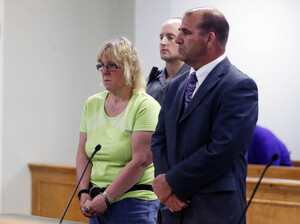 Joyce Mitchell is arraigned in City Court on Friday in Plattsburgh, N.Y. Mitchel is accused of helping two convicted killers escape from Clinton Correctional Facility, where she is an employee.