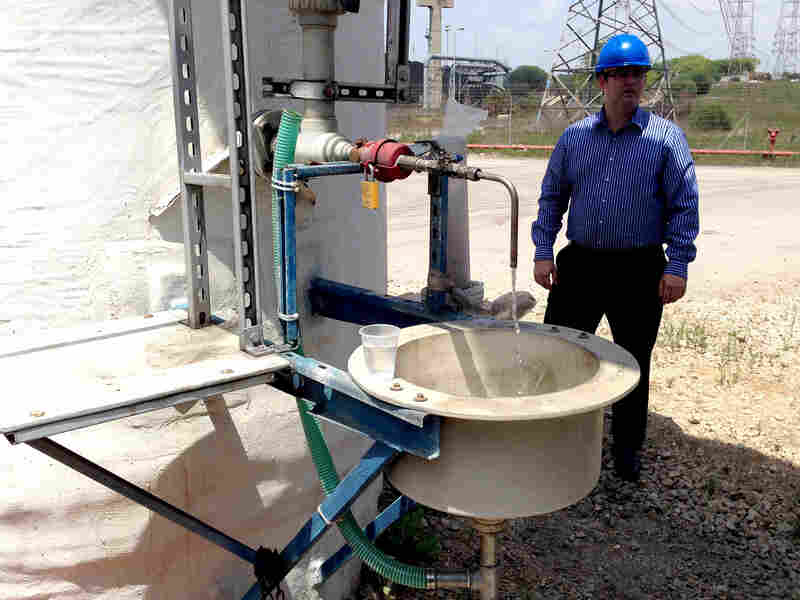 Tomer Efrat, a manager at IDE Technologies, stands near a tasting faucet at the Hadera desalination plant.