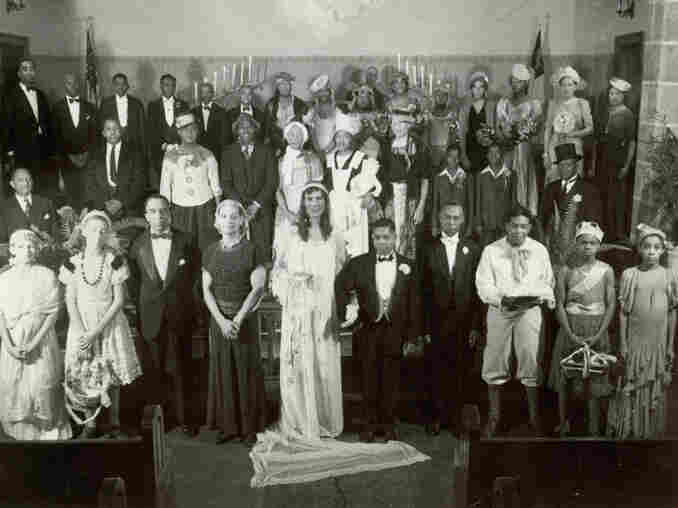Womanless weddings, like this one in a Methodist Church in Cincinnati, Ohio, often included prominent members of the community. Alongside the bride, with hands clasped, is Theodore M. Berry, the first African-American mayor of the city.