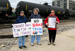 Stephanie Bilenko of La Grange, Ill. (from left), Paul Berland of suburban Elgin and Dr. Lora Chamberlain of Chicago, are members of a group urging more stringent rules for the oil-carrying trains.
