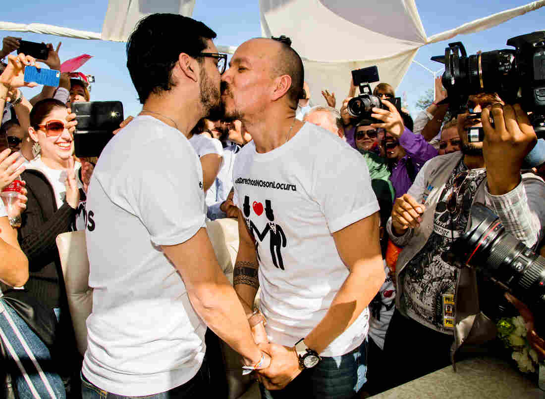 Fernando Urias (left) and Victor Manuel Aguirre kiss after they learned they were allowed to marry, during a protest outside the municipal palace in the northern border city of Mexicali, Mexico, on Jan. 17.