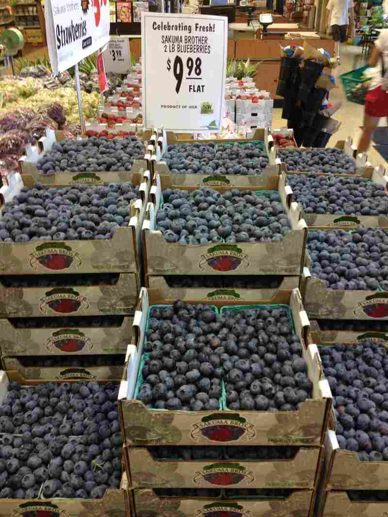 Flats of blueberries from Sakuma Brothers Farms are seen at Ballard Market in Seattle in 2013.