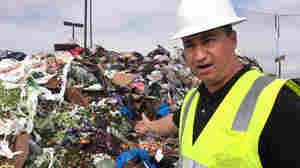 """Cesar Zuniga, operations manager at the Salinas Valley municipal dump in California, points to salad greens that still have two weeks before their sell-by date. """"Some loads ... look very fresh,"""" Zuniga says. """"We question, wow, why is this being tossed?"""""""