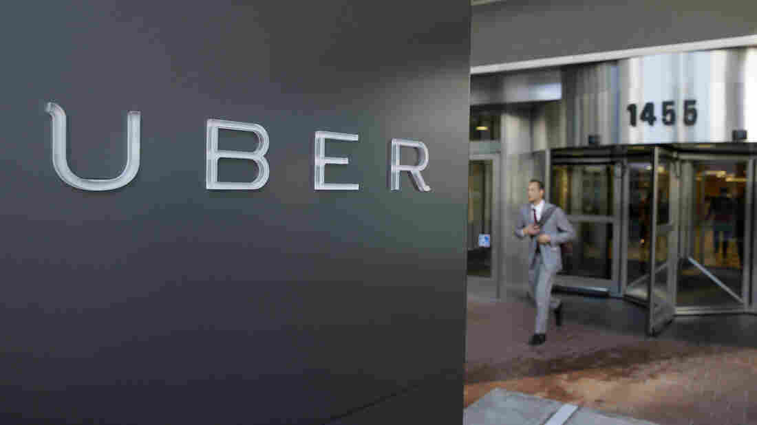 A man leaves the headquarters of Uber in San Francisco. The California Labor Commission has ruled that one Uber driver in California is an employee of the company, and is owed certain benefits.