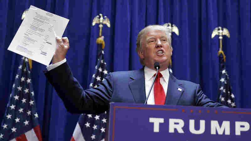Donald Trump displays a copy of a summary of his net worth during his presidential announcement Tuesday.