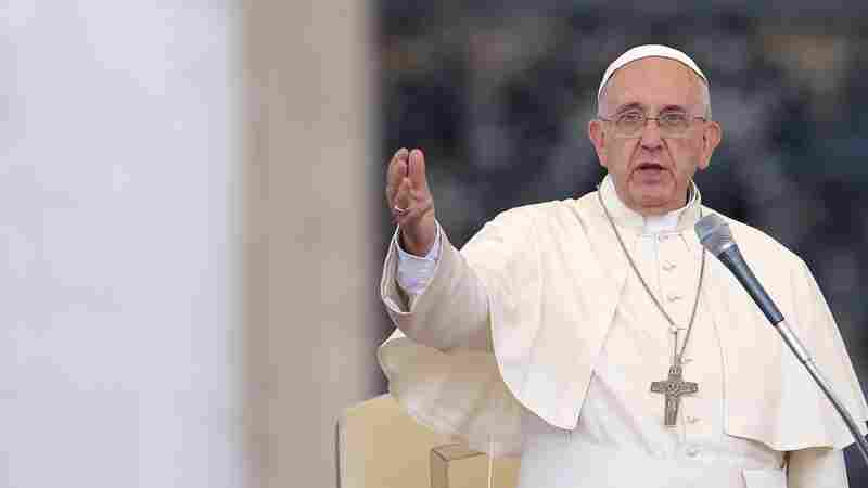 Pope Francis speaks to crowds gathered Sunday in St. Peter's Square at the Vatican.