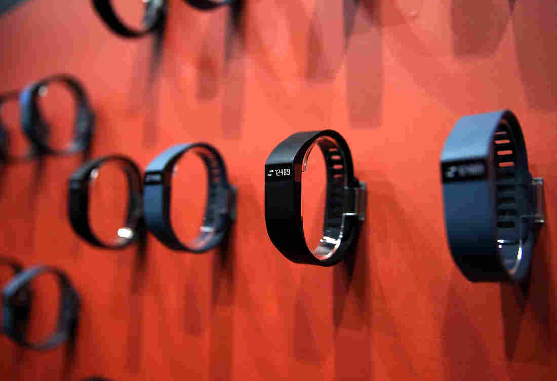 Fitbit stock begins trading publicly Thursday. The Fitbit Force is shown at the 2014 International CES, the consumer technology trade show, in Las Vegas.