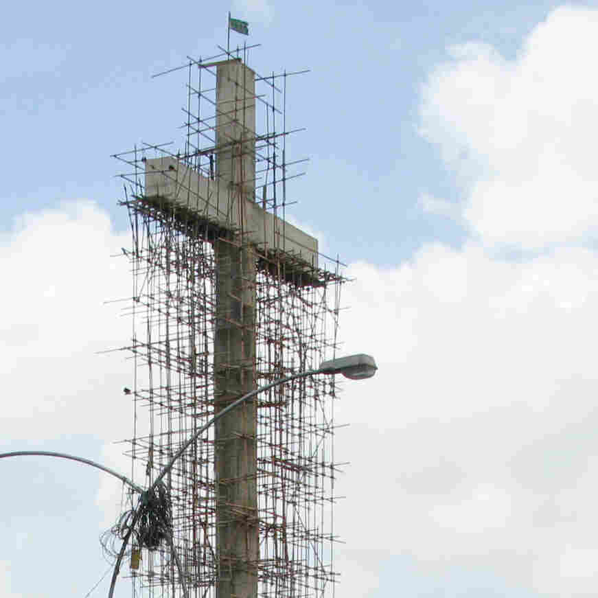 "Parvez Henry Gill, a devout Christian, is building a 140-foot cross in Karachi, Pakistan. Christians are a tiny minority in mostly Muslim Pakistan and are sometimes targeted in violent attacks. Gill says he has received many threats, but calls the cross a ""symbol of peace."""