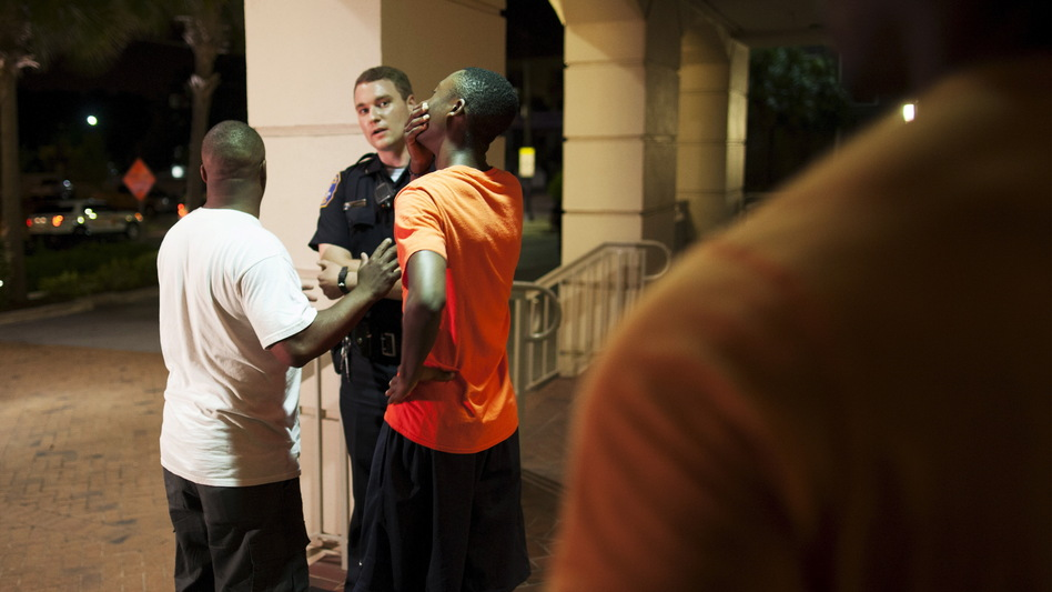 A man reacts while talking to police officer Wednesday night near the scene of shooting at the Emanuel AME Church in Charleston, S.C. (Randall Hill/Reuters/Landov)
