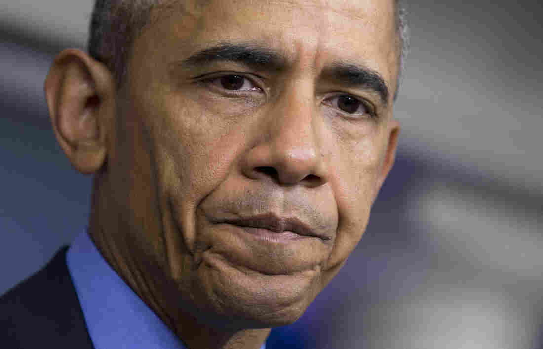 President Obama pauses while speaking in the White House Briefing Room about the church shooting in Charleston, S.C.