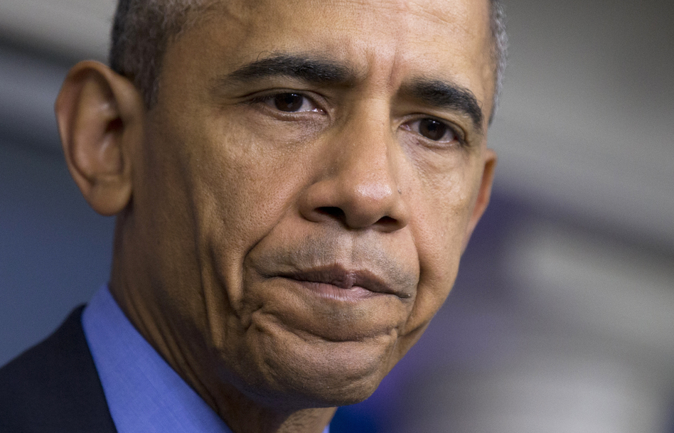 President Obama pauses while speaking in the White House Briefing Room about the church shooting in Charleston, S.C. (Manuel Balce Ceneta/AP)