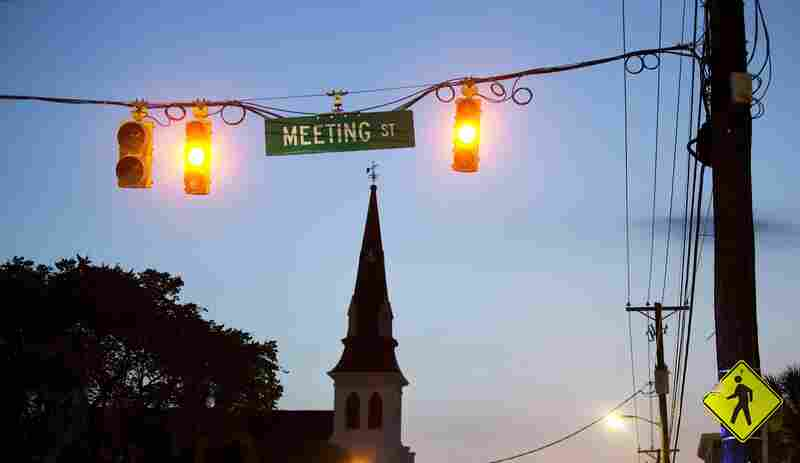 The sun rising behind the steeple of Emanuel AME Church the morning after nine people were shot and killed inside.